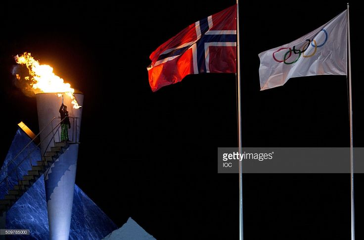 In this handout image supplied by the IOC, The Norwegian Flag and the Olympic Flag fly over Lysgrdsbakkene Ski Jumping Arena as the flame of the Lillehammer 2016 Winter Youth Olympic Games gets delivered to the cauldron by Her Royal Highness Princess Ingrid Alexandra of Norway during the Opening Ceremony of the Lillehammer 2016 Winter Youth Olympic Games on February 12, 2016 in Lillehammer, Norway.
