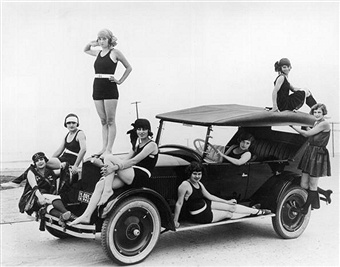 Circa 1924 Seven Women Wearing Bathing Suits Pose In And On An Automobile Parked