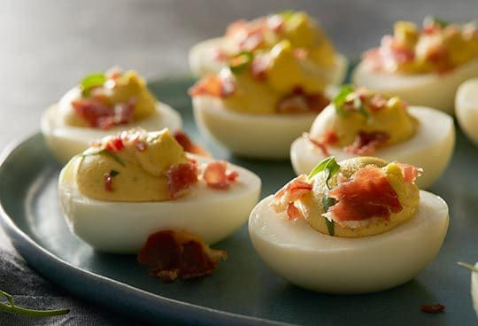 Goat cheese and crispy Bayonne ham take deviled eggs to the next level.