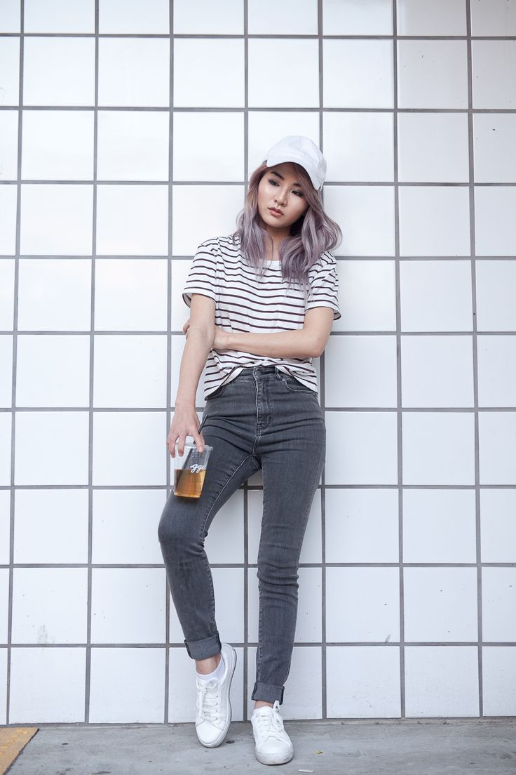 Back to Basics with Grana | Atsuna Matsui Stripe tee shirt with gray denim jeans for casual outfit. White baseball cap paired with white topshop cyprus trainers.