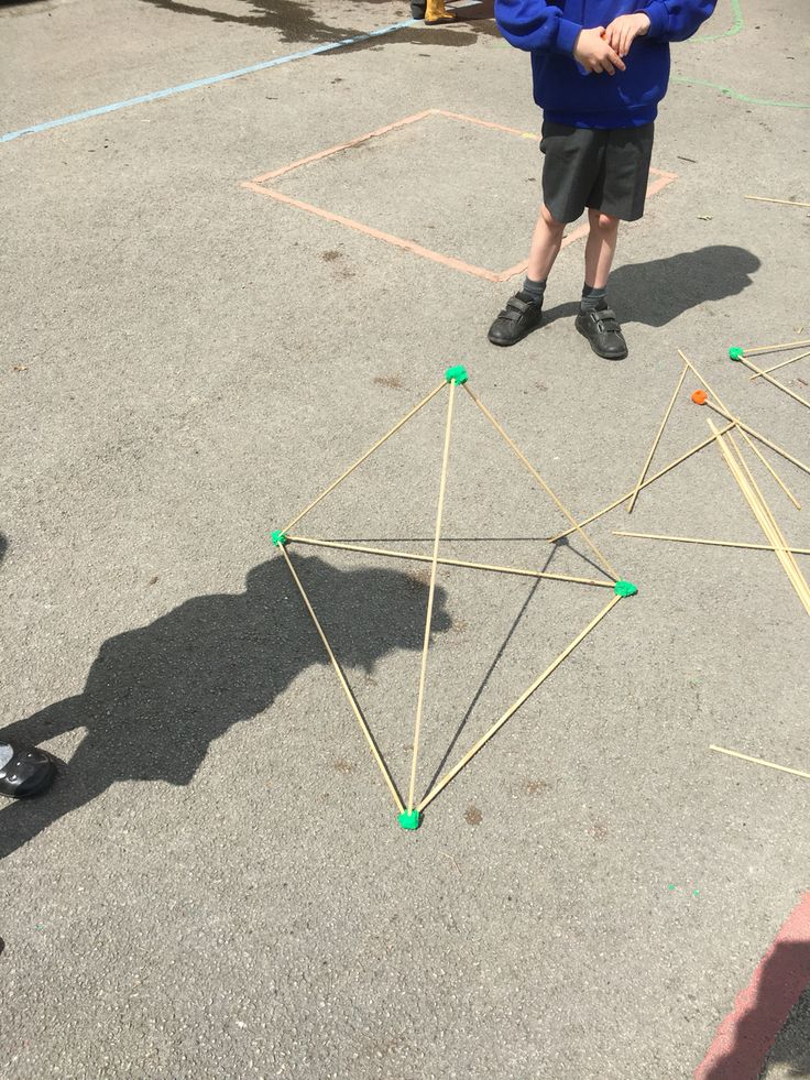 Making 3D shapes outside with sticks and plasticine