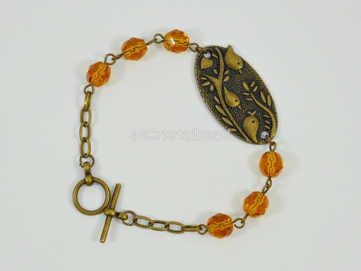 Bronze bird and yellow amber Czech fire polished bead bracelet. FSM0084