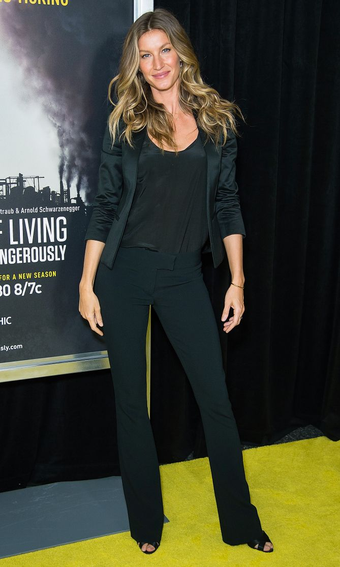 Gisele Bundchen in a black blazer, top and pants