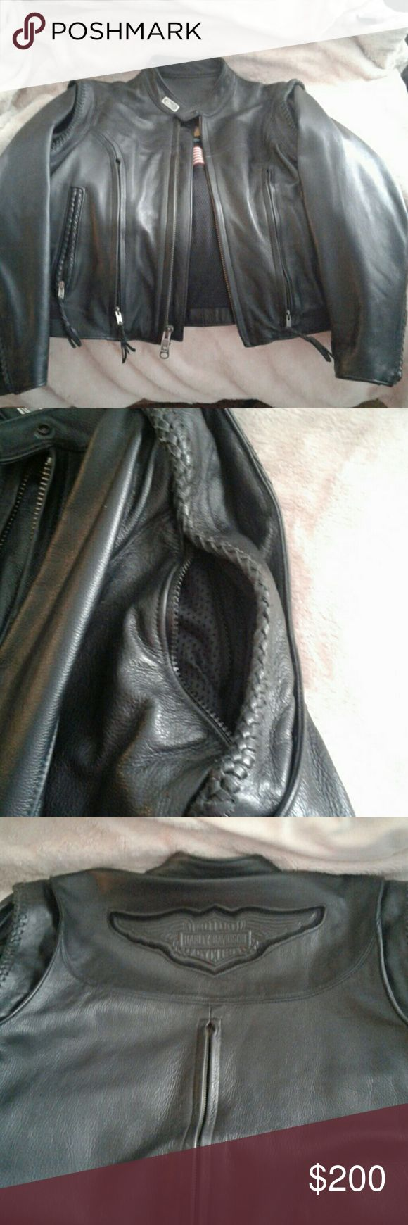 Harley Davidson women's leather riding jacket Perfect condition HD leather riding jacket. Sleeves can be removed so it is like a vest (2nd pic shows zip out option) pic 3 shows back of jacket with vent and Harley Davidson. Also has a zip out liner as shown in pic 4. Love this jacket but I have started wearing a different style of jacket. Size is a woman's XL. Sorry not part of a bundle. Harley-Davidson Jackets & Coats