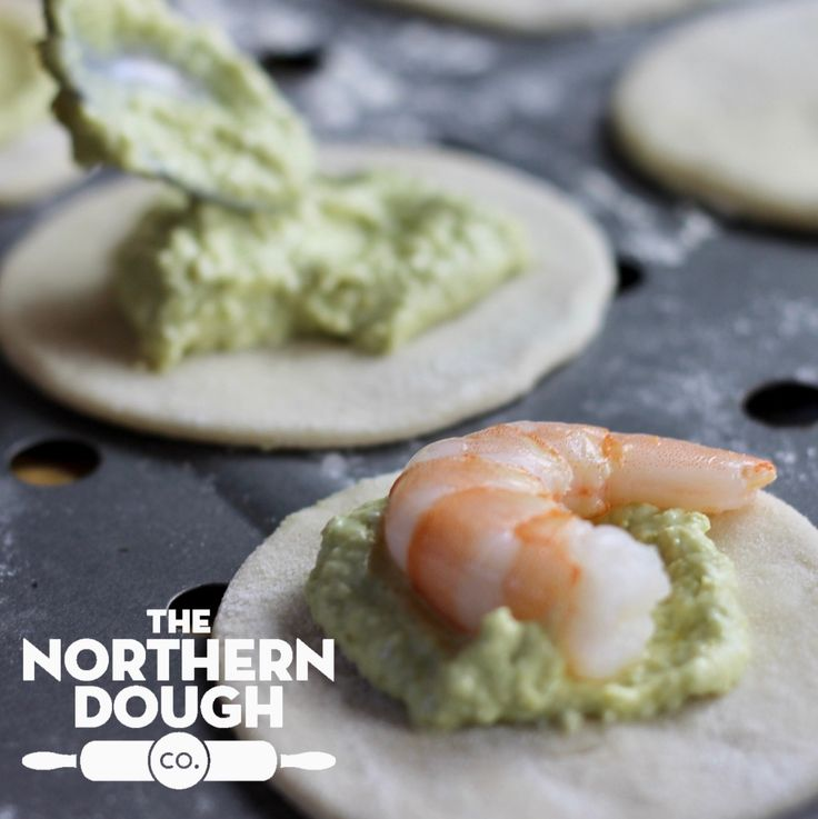 Create these quick and easy sophisticated canapés by topping some freshly baked Northern Dough Co. dough with pesto and king prawns. #pizzadough #canapes #dinnerpartyfood