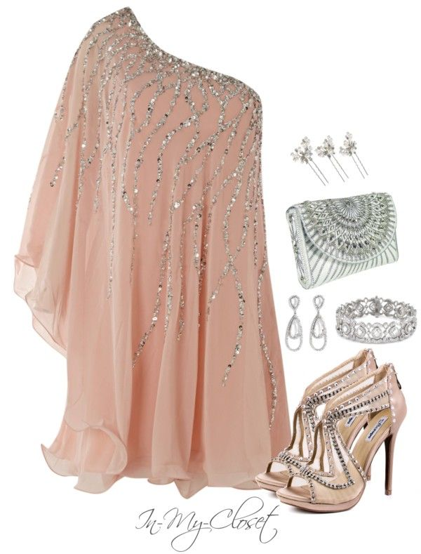 Beautiful, flowy, sparkly dress with glam accessories. Looks more like a tunic to me.. But pretty