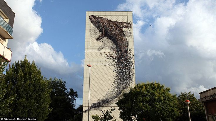 This breathtaking image of a dolphin leaping out of the water is painted on a building in Melun, in the south-eastern suburbs of Paris
