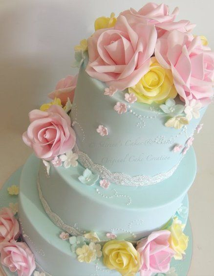 A blue and pink wedding cake in soft hues makes for a very traditional color scheme with modern influences.