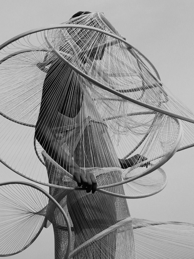 Architectural Fashion with sculptural spiralling structure encircling the body | Baiba Ladiga