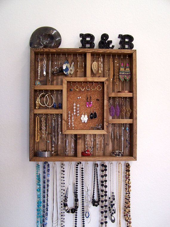 Jewelry display box for your bedroom wall. The display case holds earrings, rings, necklaces, pins, watches, and bracelets. Organize your