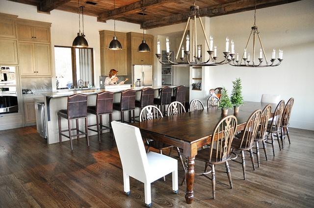 wood floors, large wood table, rustic chandeliers, wood beam ceilings