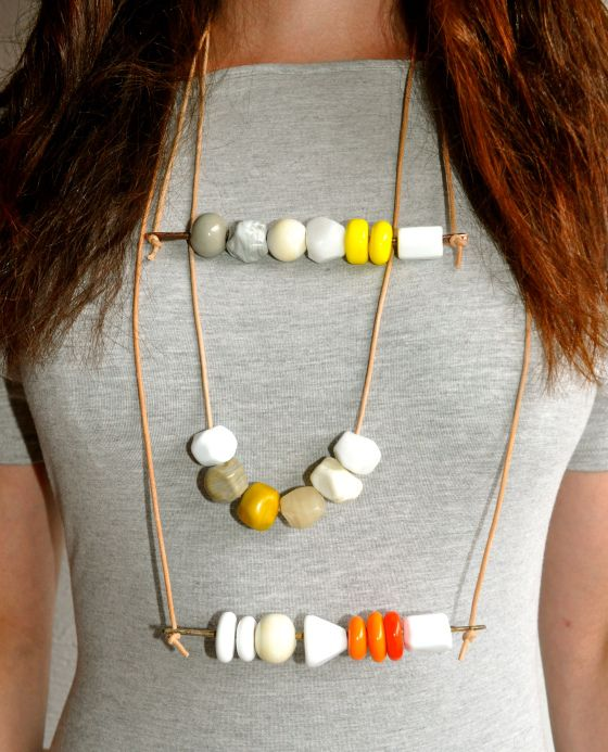 Synergy Glass Art necklaces. Lampwork beads, natural leather, antique metal.