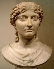 Julia Agrippina, most commonly referred to as Agrippina Minor or Agrippina the Younger, and after 50 known as Julia Augusta Agrippina was a Roman Empress and one of the more prominent women in the Julio-Claudian dynasty. She was a great-granddaughter of the Emperor Augustus, great-niece and adoptive granddaughter of the Emperor Tiberius, sister of the Emperor Caligula, niece and fourth wife of the Emperor Claudius, and mother of the Emperor Nero.