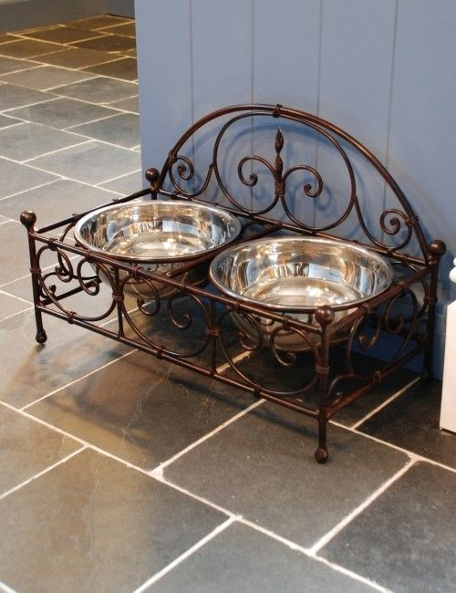 Treat your pet with these beautiful dog bowls.This wrought iron double feeder keeps your dog's food elevated from the ground and will also add a decorative touch to your kitchen. The stainless steel bowls come out easily so are easy to clean.