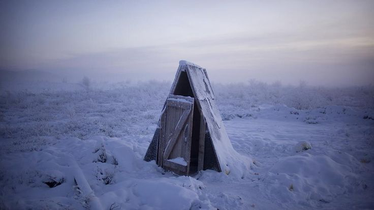 Winter temperatures in Oymyakon, Russia, average minus -50 C ( minus -58 F). A toilet on the tundra at a petrol stop on the road to Oymyakon. Most toilets in the area are long drops as the constantly frozen soil makes difficult to dig plumbing.