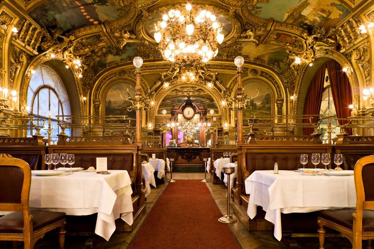 Le Train Bleu, opulent restaurant built in 1901. Grandiose sculptures, mural-covered walls & ceilings, crystal chandeliers & shiny brass fittings. Famous regulars: Coco Chanel & Salvador Dali.