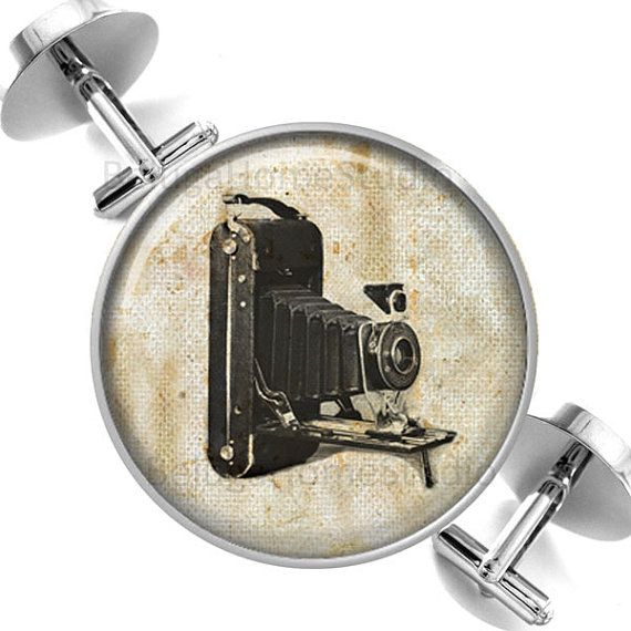 Pair of Cufflinks Vintage Camera on Sepia Grunge Background    These high quality round silver cufflinks are protected by a clear resin and printed on pearl metallic paper which has an iridescent depth and luster that is so beautiful.    These cufflinks measure approx 1 inch with a