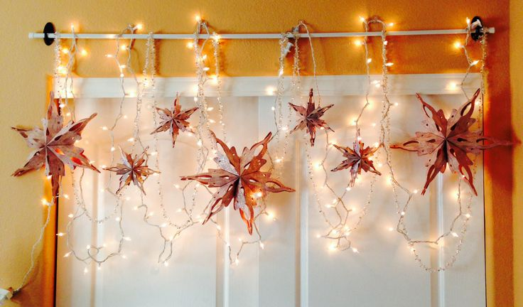 Simple Christmas room decor! all you need are command hooks, a bar, lights, garland, and cute stars  (stars from target).