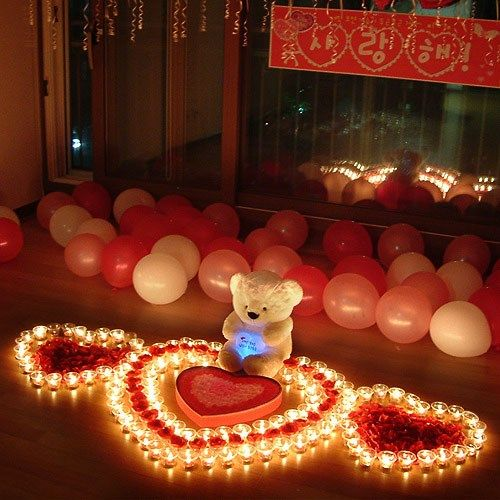 Using Battery Powered Candle Lights To Form Hearts For Her