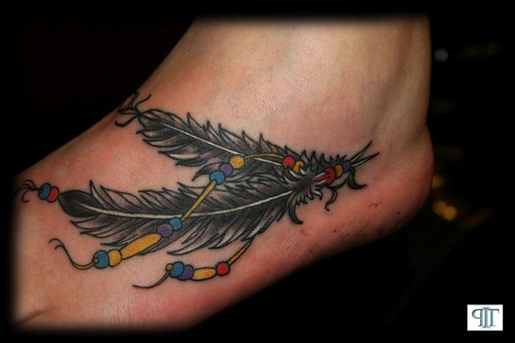 feather-tattoo-designs.com736 x 490 · jpegNative American Feather Tattoos Foot  60 amazing native American feather tattoos If you feel like the Indian feather tattoo is not for you, please be sure to check out more tattoo designs, ideas, and meanings in the links below.thelyricwriter.hubpages.com