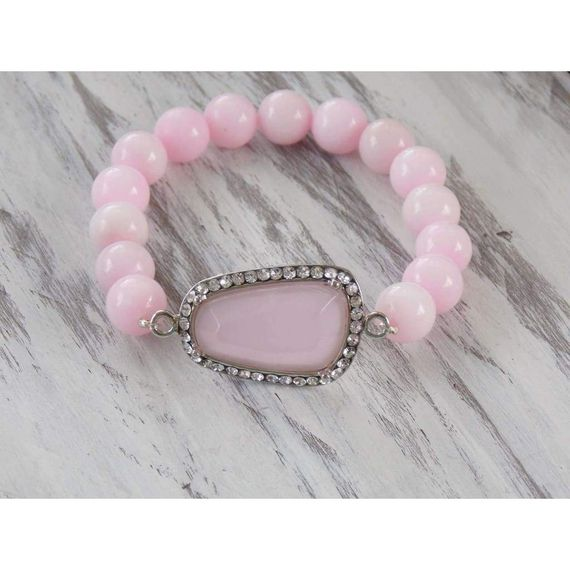 This sweet #bracelet is composed with pink jade and a pink pave focal bead. This beauty is a perfect addition to your bracelet collection or simply devine as a starter.. Eit… #bogo #bracelets #holidaycollection #jewelry