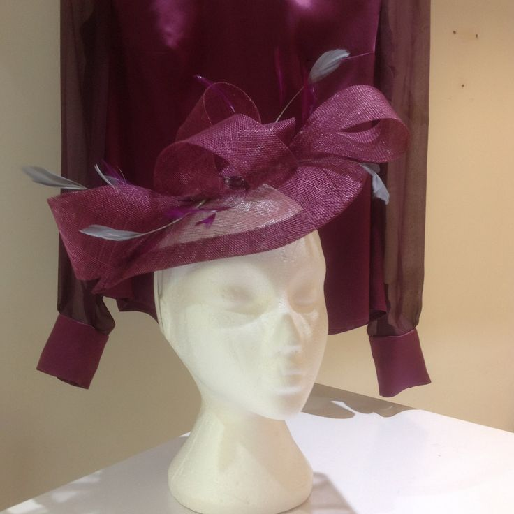 Plum and silver grey coloured sinemay and feather hat/ fascinator.  Made to order to match the silk outfit. #motherofbride #weddinghat #hat #wedding #luxury #designerwedding #couture #motherofgroom  #bridalcouture #dressmaker #lesleycutlerbridal #fascinator #weddinginspo #mk #miltonKeynes #buckinghamshire #bucks #herts #oxfordshire