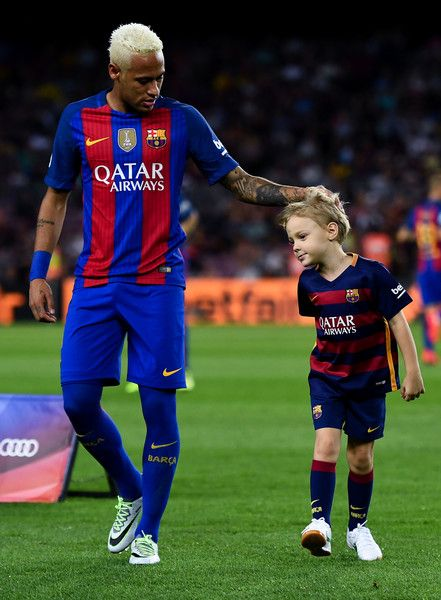 Neymar Jr. of FC Barcelona holds his son Davi Lucca prior to the La Liga match between FC Barcelona and Deportivo Alaves at Camp Nou stadium on September 10, 2016 in Barcelona, Catalonia.