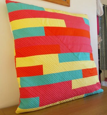 thREDhead: Greek Cross Cushion - strip pieced back, diagonal straight line quilting across half of it giving a lovely texture contrast!