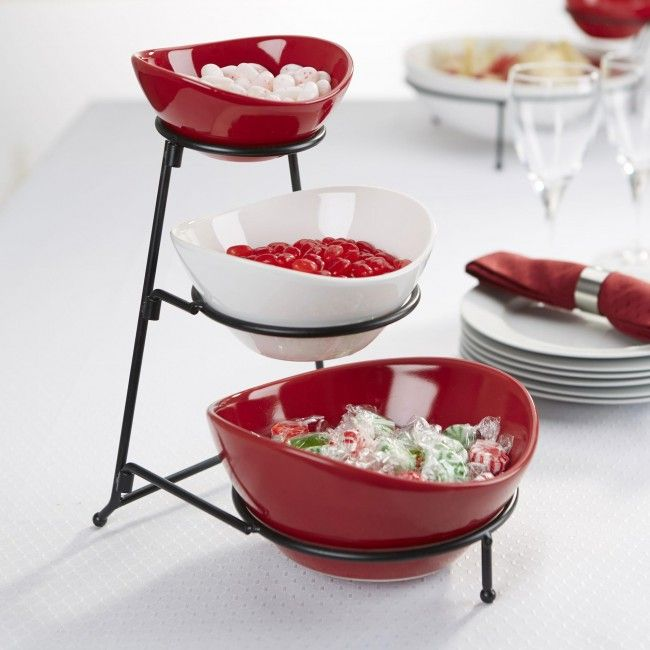 Our Strata 3-Tier Buffet Bowls are a perfect way to display and serve party dips, chips, salsa, nuts and delicious holiday treats! The red and white ceramic bowls sit on a collapsible metal stand, complimenting your holiday decor while still being usable all year round! When not in use the bowls stack and the stand collapses for easy storage in your kitchen cupboard.