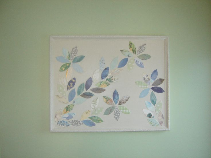 old picture, I painted over including the frame and then added a design of cut outs from old greeting cards and then sealed with a clear coat. idea inspired by pinterest.  now hanging in the kitchen, my husband decided that was the best place for it.