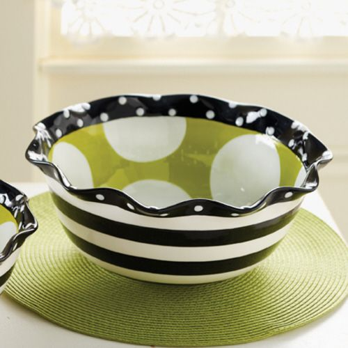 Hand painted inside and out, this ceramic serving bowl from Mud Pie's Ruffles collection features white polka-dots against a green interior, a black striped exterior and a black with white polka dot ruffled rim. This darling piece perfectly matches the complete Mud Pie Ruffles collection.