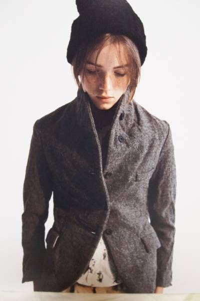 Small jacket   Collar up   Black hat   Paul Harnden
