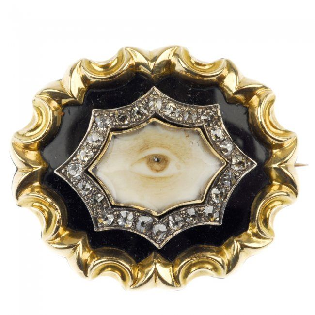An early Victorian sentimental gold and diamond eye miniature brooch, the eye portrait miniature, within an old-cut diamond surround, to the black enamel and scalloped edge