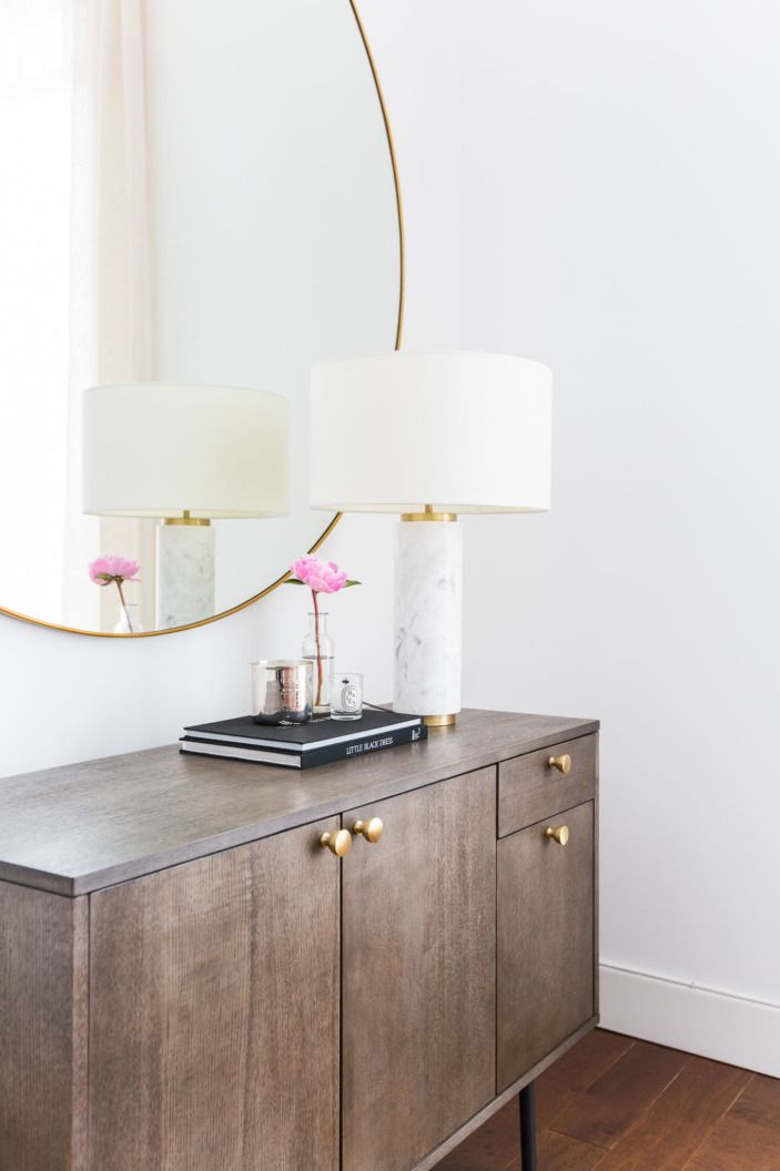 """More brass and marble accents comes through with hardware and this sleek <a href=""""http://westelm.7eer.net/c/343160/277866/4336?aadid=5158621&u=http%3A%2F%2Fwww.westelm.com%2Fproducts%2F5158621%2F%3FcatalogId%3D71%26sku%3D5158621"""" target=""""_blank"""">lamp</a> from West Elm."""