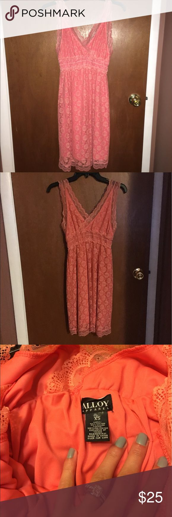 Peach/Pink Lace overlay Summer Dress New without tags Alloy pink/peach lace dress.   This is perfect spring/summer dress with its cute Lace overlay. It's light weight and fun to wear!   Perfect for outdoor BBQs and parties! ALLOY Dresses