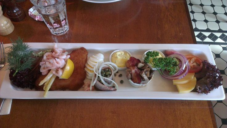 Piatto a base di #pesce #gamberi #merluzzo #salmone ad #Oslo
