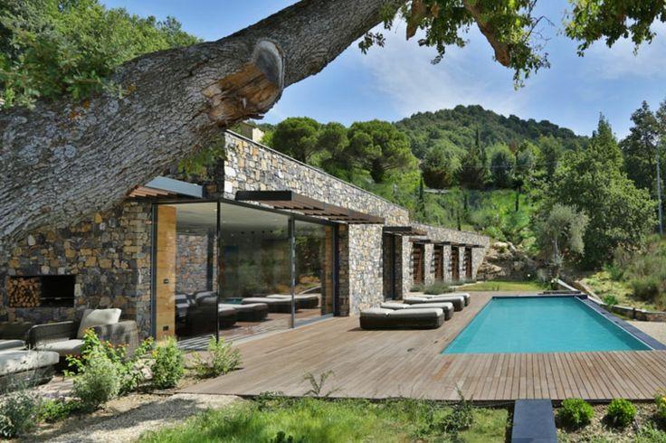 Maison en pierre conçue par Giordano Hadamik Architects