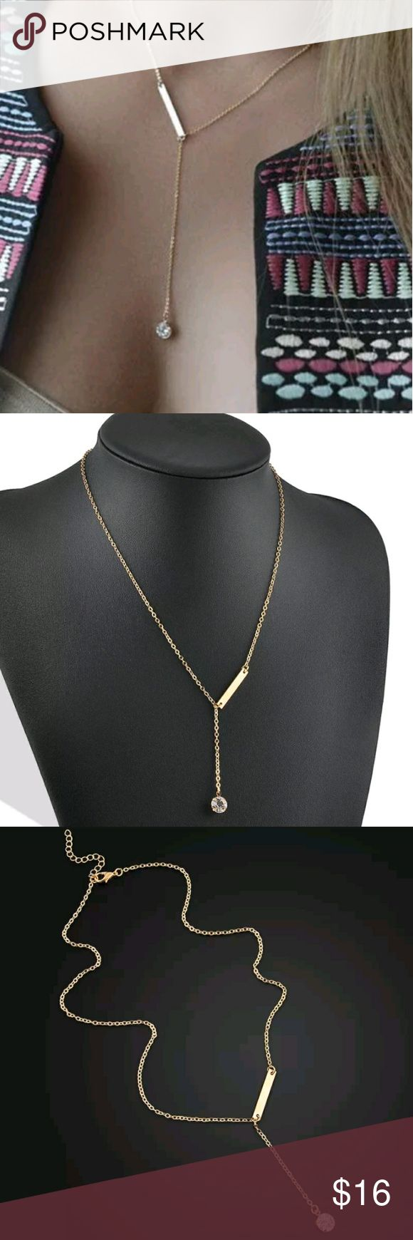 Gold Layered Rhinestone Bar Necklace Very pretty dainty long gold necklace with charms. Bar and circle jewel.  On trend and super classy.  Brand new and perfect!     Tags bohemian boho hippy dainty girly choker necklaces stacking charms charm coin coins bar minimalist layered layers Jewelry Necklaces
