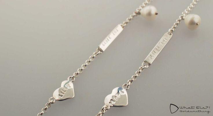 zusjesarmbandjes van zilver met een parel