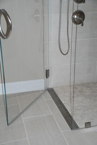 shower pan? Curbless shower with a linear drain at the door. This would be so much easier to clean!