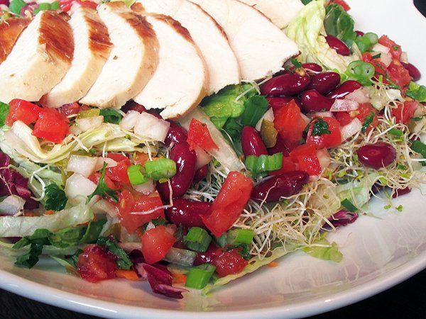 This salad was one of the first six selections offered when Chili's Guiltless Grill premiered on the chain's menu in 1993. You'll love the Southwestern flavors in this delicious and healthy salad clone. The marinated grilled chicken has a sweet, smoky taste, and the pico de gallo lends a nice zip to the dish. Top it all off with irresistible Southwest dressing and you'll have a meal-size salad that comes in at only 5 grams of fat.Nutrition Facts Serving size–1 salad Total serv...