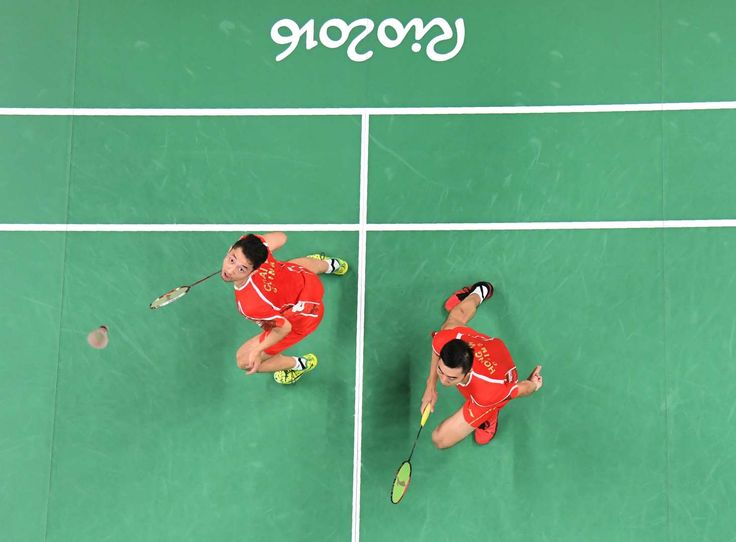 Birdie's eye view:      China's Chai Biao, left, and Hong Wei return against Great Britain's Marcus Ellis and Chris Langridge during their bronze-medal match in doubles badminton on Aug. 18.