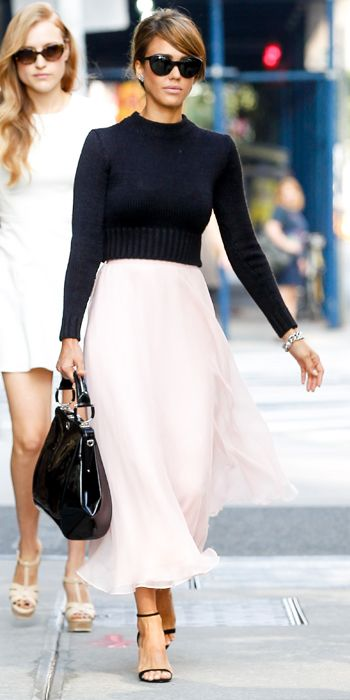 pale pink midi skirt, a black long-sleeve knit sweater and black accessories, all by Ralph Lauren. Jewelry wise, she wore Jamie Wolf earrings and an EF Collection ring.
