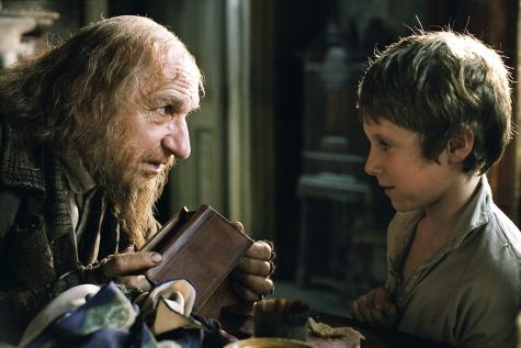 Fagin - noun: One who trains others, especially children, in crime.  A.Word.A.Day (January 31, 2012)