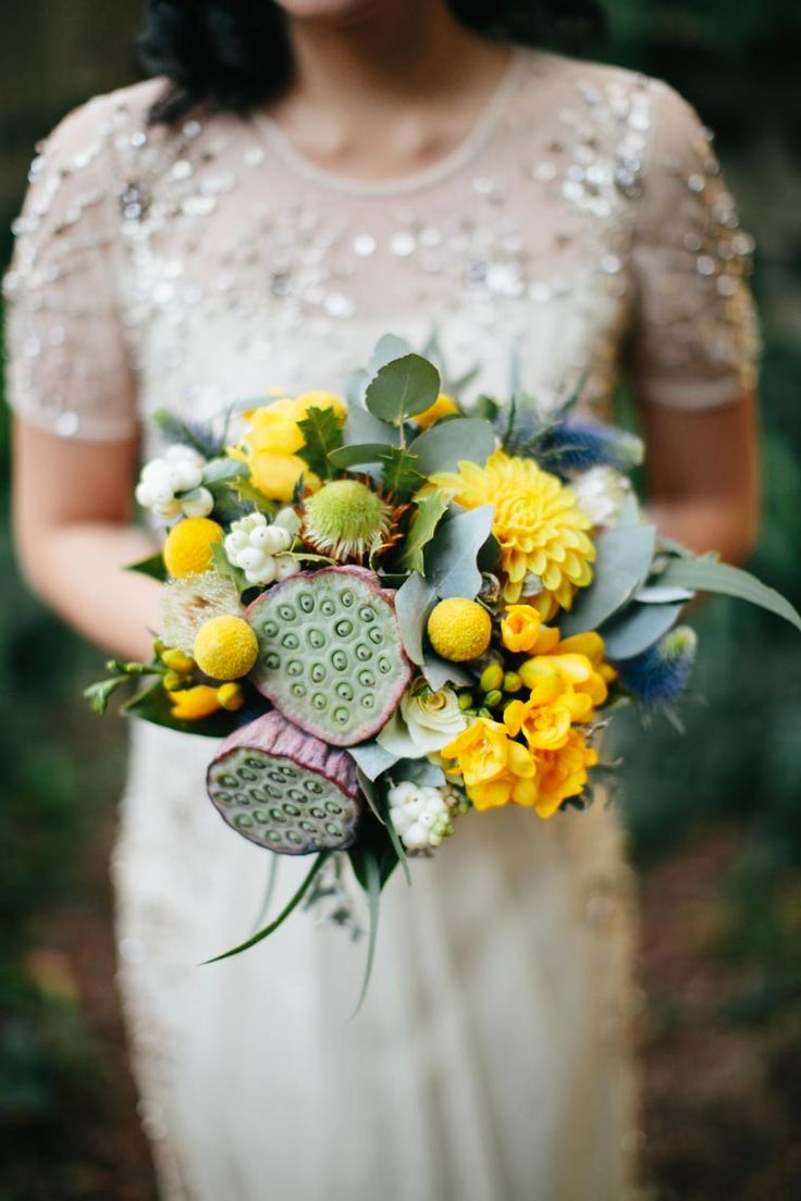 135 best lotus pod images on pinterest lotus bridal yellow bouquet with lotus pods and billy buttons dhlflorist Image collections