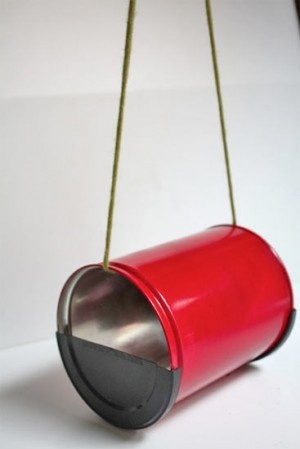 """bird feeder made from metal coffee can.   Cut bottom off, cut plastic lid in half placing a half at ea. end, (gluing to hold in place)  Either run weather-proof string, twine or use leather shoe lace through can or punch holes to hang then fill w/ seed and """"watch the birdie""""!"""