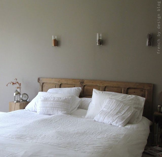 Love the idea of an old door for a headboard.