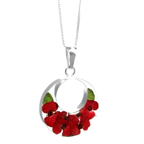 "Poppy Double circle necklace. An elegant pendant made with a real flower encased in resin, mounted with sterling silver and an 18"" rhodium plated sterling silver chain"