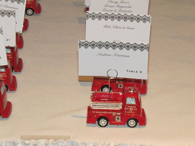 For a firefighter groom these fire truck place cards are adorable! It makes for a very fun and personalized wedding as well!. Check out that cool T-Shirt here: https://www.sunfrog.com/I-love-my-firefighter-Black-Ladies.html?53507