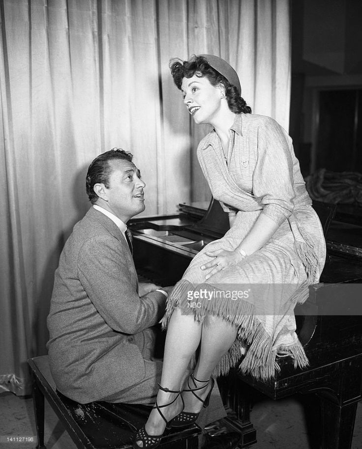 Kay Starr...don't know who the piano player is though.